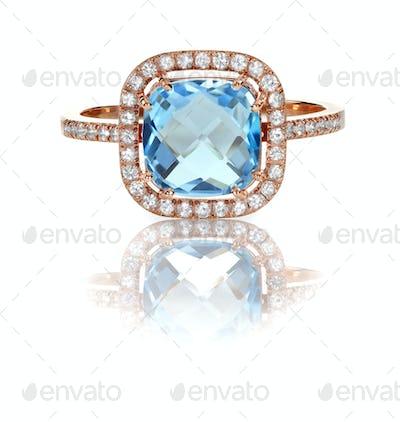 Beautiful Blue Topaz and diamond Rose Gold Halo Ring
