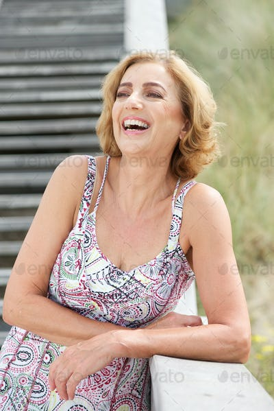 Mature woman laughing outdoors