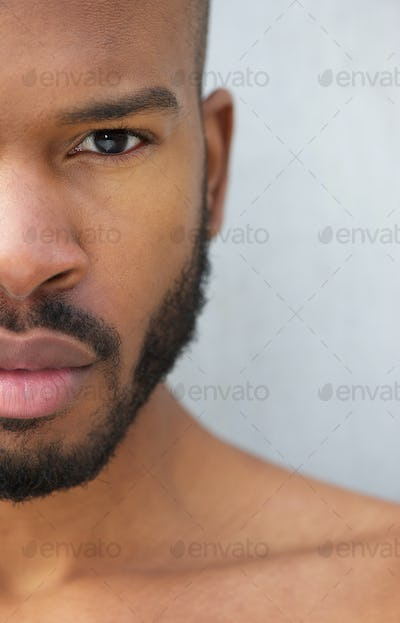 Half face portrait of a handsome young african american man