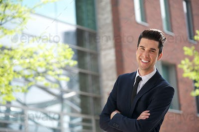 Handsome young businessman smiling outdoors