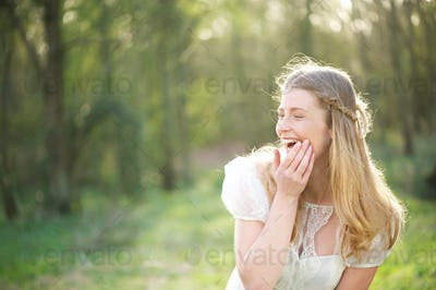 Portrait of a beautiful young woman laughing outdoors
