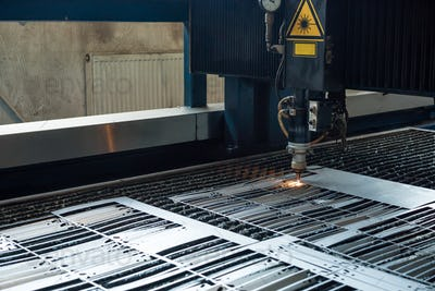 laser head cutting metal sheets into plates