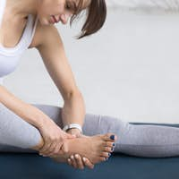 Woman massaging her foot during sport practice