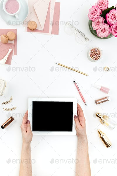 The female hands and tablet