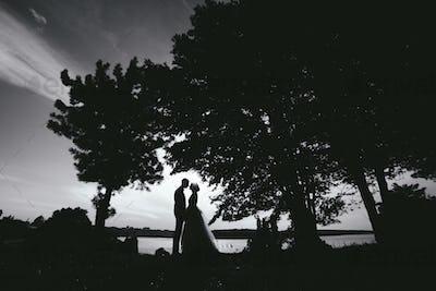 bride groom standing in the park