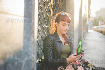 Young handsome caucasian redhead woman using smartphone holding