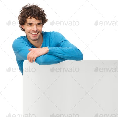 Smiling Man Leaning on Blank Signboard