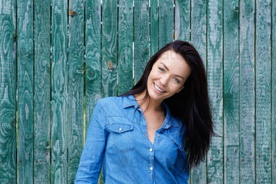 Smiling brunette woman with blue shirt