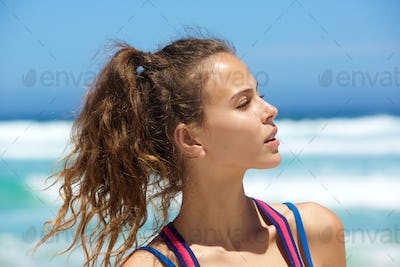 Close up beautiful young woman at the beach