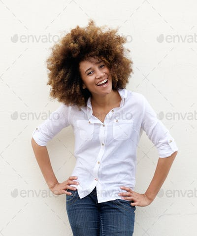 Young woman laughing with white shirt ad afro hair