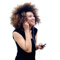 Smiling young african woman listening to music