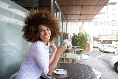 African american woman enjoying cup of coffee at cafe