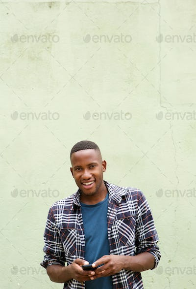 Stylish african man with a mobile phone smiling