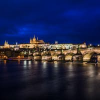 View at night across the Vltava River in Prague with Charles Bri