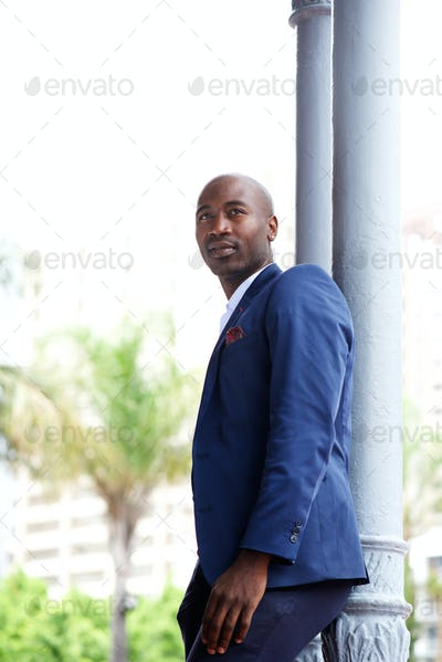 Handsome young african businessman looking away