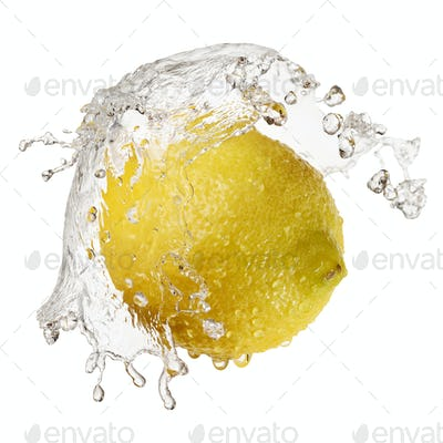 Yellow lemon in splash of water