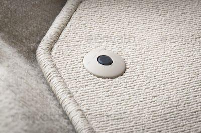 Corner of car mat with floor holder
