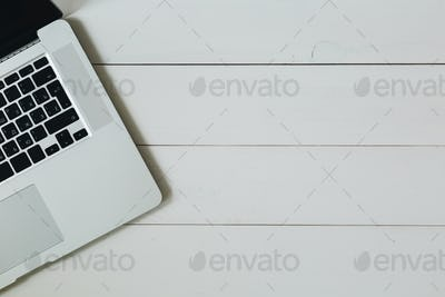Laptop on the white wooden desk