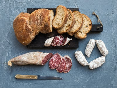 Wine snack set. Italian slami sausages and rustic bread
