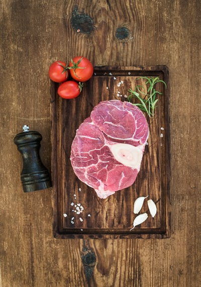 Raw fresh beef meat cross cut for ossobuco with garlic cloves