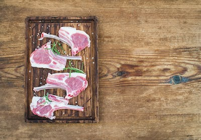 Raw lamb chops. Rack of Lamb with rosemary and spices