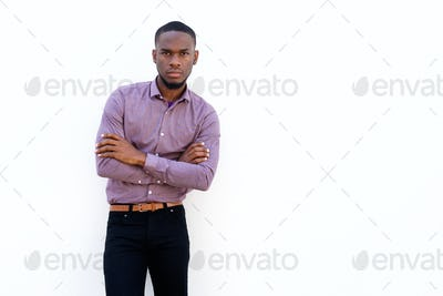 Young african man standing with his arms crossed
