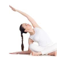 Side bending Sukhasana yoga pose