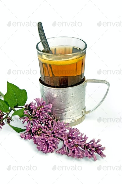 Tea in a glass with lilac