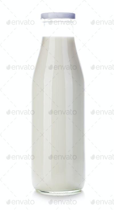 Bottle of milk close-up isolated on white background.