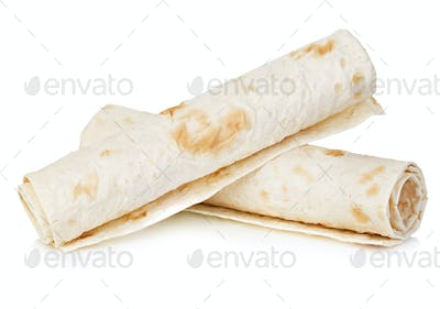 Wheat round tortillas close-up isolated on a white background. Lavash.