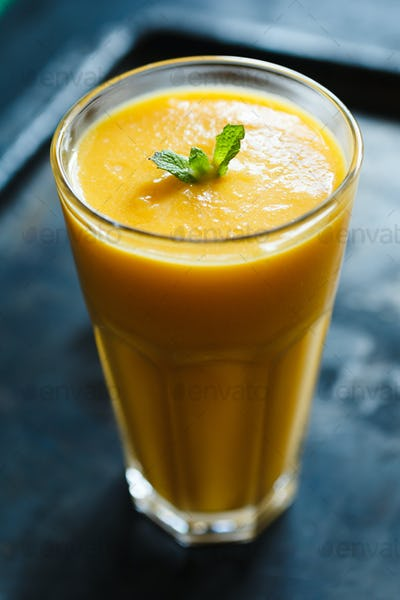 orange smoothie in the glass