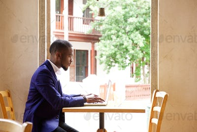 Young businessman working laptop at cafe