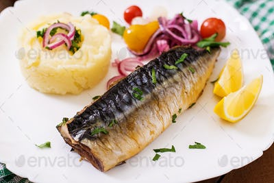 Baked mackerel with herbs and garnished with mashed potatoes and pickled vegetables