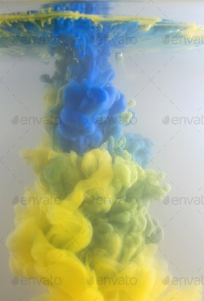 Blurred blue and yellow ink in water