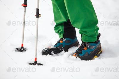 Hiking boot closeup on mountain snow