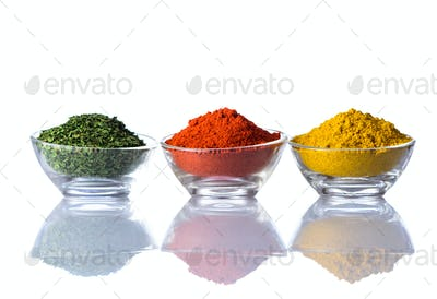 Dried Herbs, Paprika and Curry Powder on White