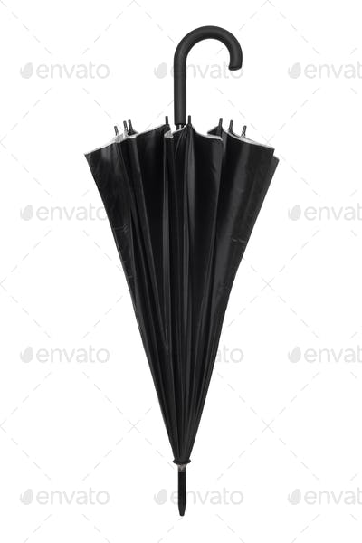 Black closed umbrella isolated on white, clipping path included