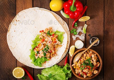 Ingredients for Burritos on wooden background. Top view