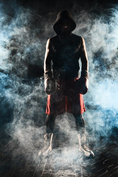 The young  man kickboxing