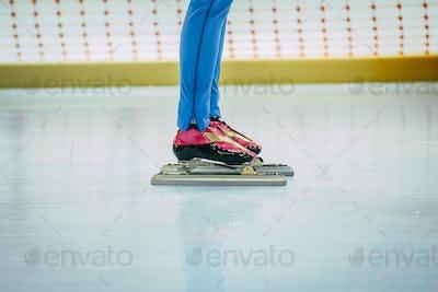 closeup feet girl speed skaters