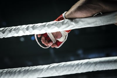 closeup hand of fighter MMA in glove