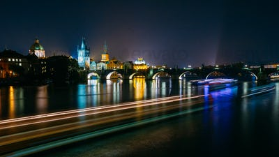 Night panoramic view of illuminated Charles Bridge in Prague, Cz