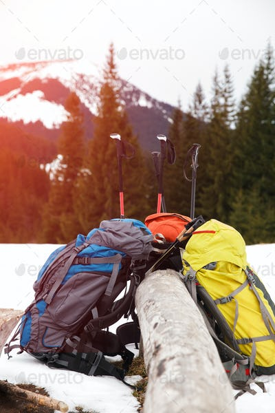 Backpacks on snow in winter mountains