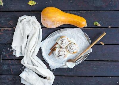 Cinnamon pumpkin buns with creamy cheese icing and ripe pumpkin