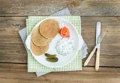 Draniki: potato pancakes with smoked salmon, cornichons and crea