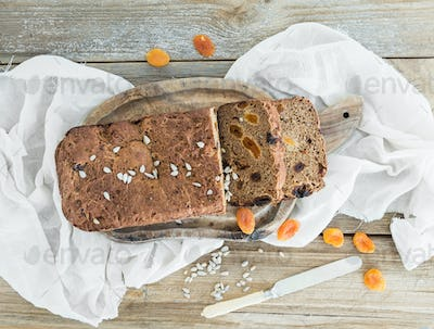 Home-made whole grain bread with dried fruit, seeds and nuts on