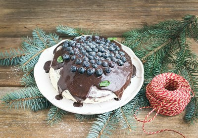 Christmas chocolate celebration cake with chocolate ganache, cre