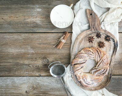 Village style breakfast set: sweet cinnamon ring bread and a cup