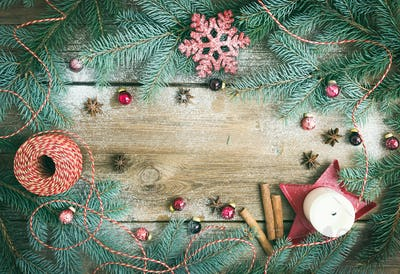 Christmas decorations: fur-tree branches, colorful glass balls,