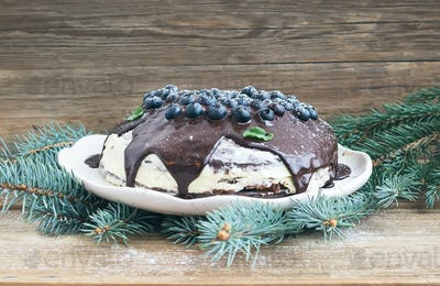 Christmas chocolate cake with chocolate ganache, cream-cheese fi